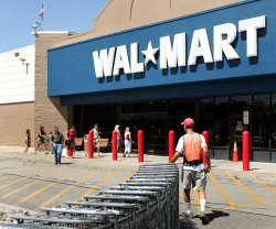 A worker collects shopping carts outside a Wal-Mart store in Mount Prospect, Ill.   (Photo by Tim Boyle/Getty Images)