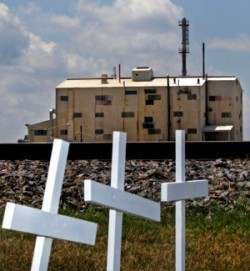 Last year, crosses were placed near the entrance to Honeywell's uranium conversion plant in Metropolis, Ill., to represent past employees who died of cancer. Workers represented by the United Steelworkers continue to be locked-out by the corporation.   (Stephanie S. Cordle/Post-Dispatch)